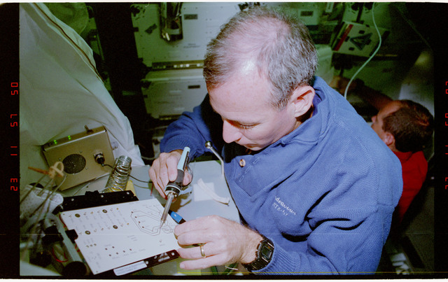 STS057-231-004 - STS-057 - Crewmember in the SPACEHAB at work on physical stability and dexterity exp.