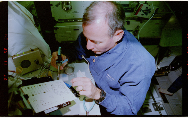 STS057-231-011 - STS-057 - Crewmember in the SPACEHAB at work on physical stability and dexterity exp.