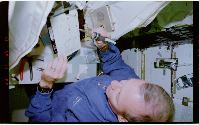 STS057-231-012 - STS-057 - Crewmember in the SPACEHAB at work on physical stability and dexterity exp.