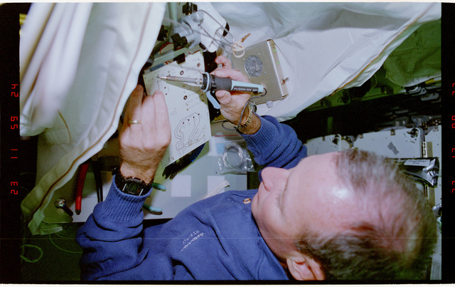 STS057-231-013 - STS-057 - Crewmember in the SPACEHAB at work on physical stability and dexterity exp.