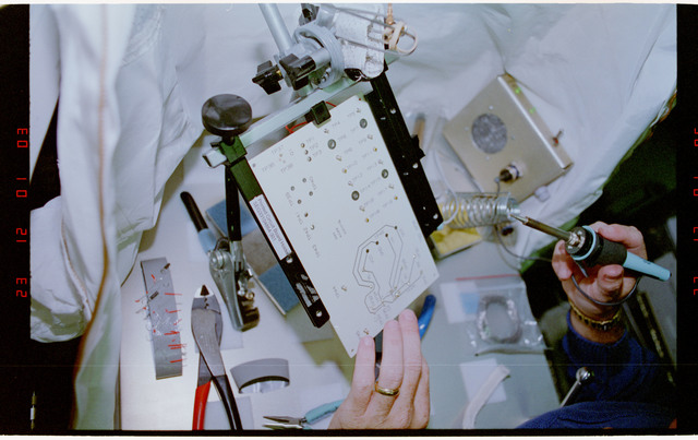 STS057-231-015 - STS-057 - Crewmember in the SPACEHAB at work on physical stability and dexterity exp.