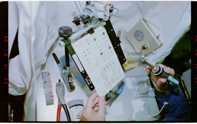 STS057-231-017 - STS-057 - Crewmember in the SPACEHAB at work on physical stability and dexterity exp.