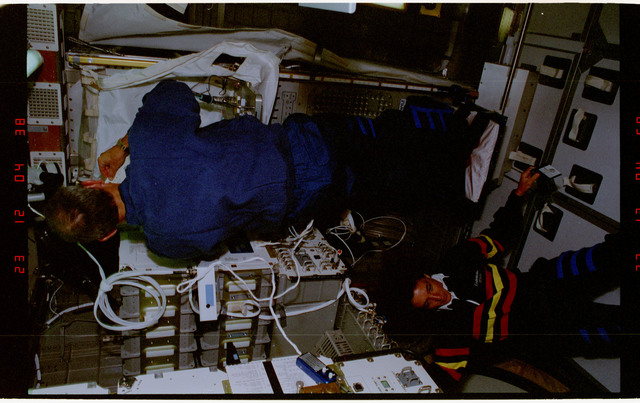STS057-231-021 - STS-057 - Crewmember in the SPACEHAB at work on physical stability and dexterity exp.