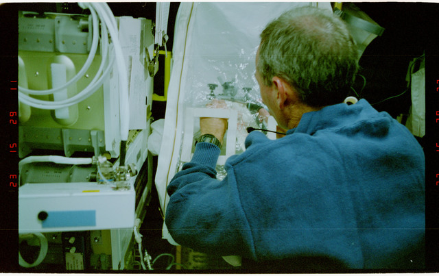 STS057-231-034 - STS-057 - Crewmember in the SPACEHAB at work on physical stability and dexterity exp.