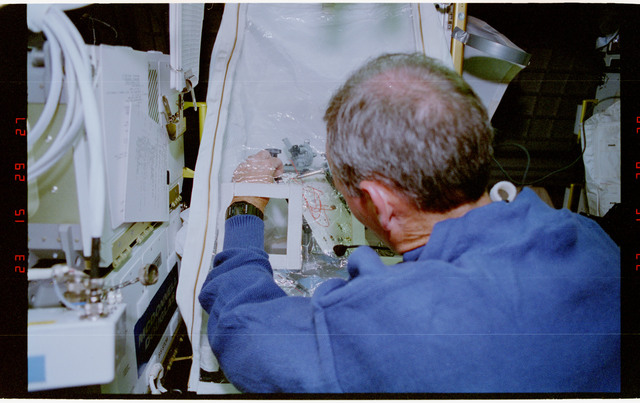STS057-231-035 - STS-057 - Crewmember in the SPACEHAB at work on physical stability and dexterity exp.