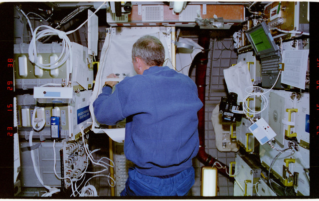 STS057-231-036 - STS-057 - Crewmember in the SPACEHAB at work on physical stability and dexterity exp.