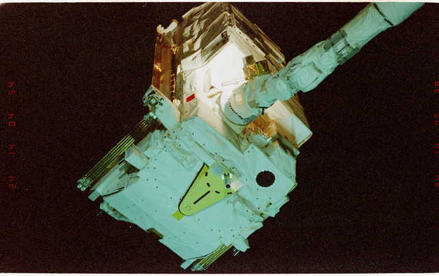 STS057-233-033 - STS-057 - Retrieval of the EUropean REtrievable CArrier EURECA Satellite by RMS.