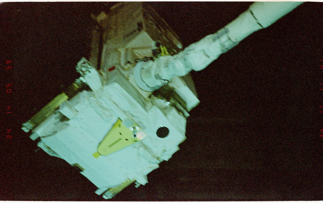 STS057-233-035 - STS-057 - Retrieval of the EUropean REtrievable CArrier EURECA Satellite by RMS.