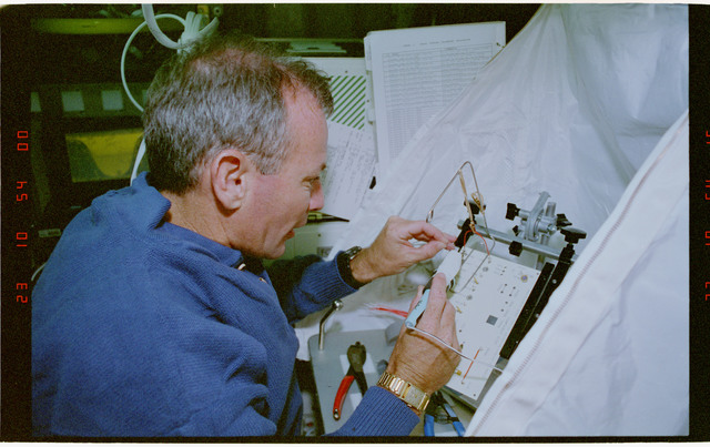 STS057-30-012 - STS-057 - Crewmember in the SPACEHAB at work on physical stability and dexterity exp.