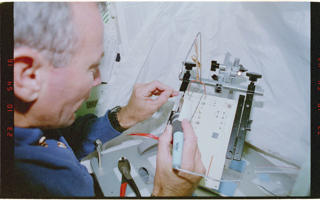 STS057-30-013 - STS-057 - Crewmember in the SPACEHAB at work on physical stability and dexterity exp.