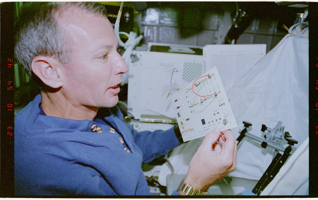 STS057-30-014 - STS-057 - Crewmember in the SPACEHAB at work on physical stability and dexterity exp.