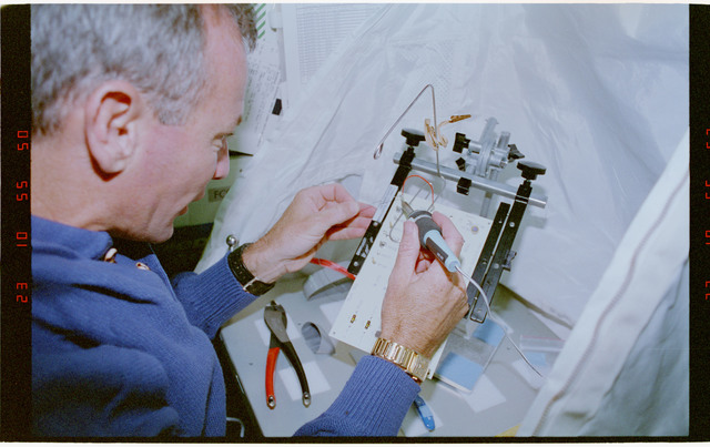 STS057-30-016 - STS-057 - Crewmember in the SPACEHAB at work on physical stability and dexterity exp.