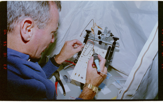 STS057-30-021 - STS-057 - Crewmember in the SPACEHAB at work on physical stability and dexterity exp.