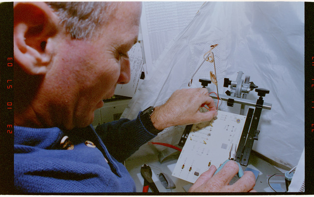 STS057-30-023 - STS-057 - Crewmember in the SPACEHAB at work on physical stability and dexterity exp.