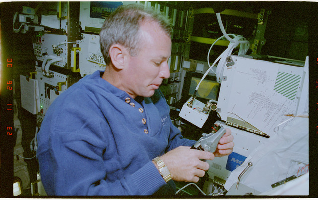 STS057-30-026 - STS-057 - Crewmember in the SPACEHAB at work on physical stability and dexterity exp.