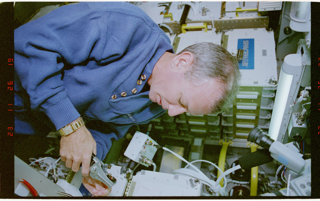 STS057-30-027 - STS-057 - Crewmember in the SPACEHAB at work on physical stability and dexterity exp.
