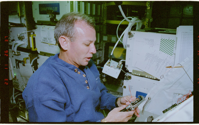 STS057-30-028 - STS-057 - Crewmember in the SPACEHAB at work on physical stability and dexterity exp.