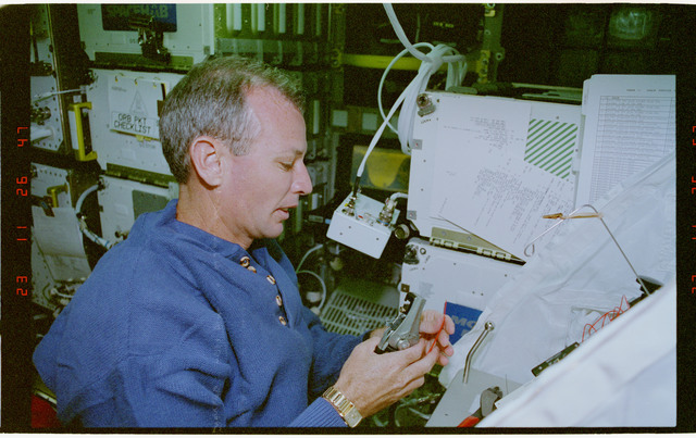 STS057-30-029 - STS-057 - Crewmember in the SPACEHAB at work on physical stability and dexterity exp.