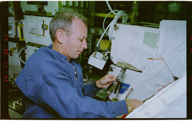STS057-30-030 - STS-057 - Crewmember in the SPACEHAB at work on physical stability and dexterity exp.