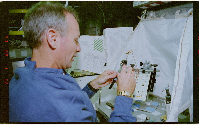 STS057-30-031 - STS-057 - Crewmember in the SPACEHAB at work on physical stability and dexterity exp.