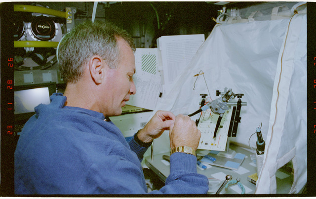 STS057-30-033 - STS-057 - Crewmember in the SPACEHAB at work on physical stability and dexterity exp.
