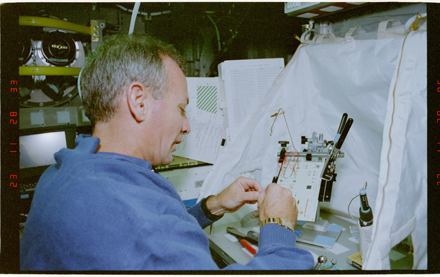 STS057-30-034 - STS-057 - Crewmember in the SPACEHAB at work on physical stability and dexterity exp.