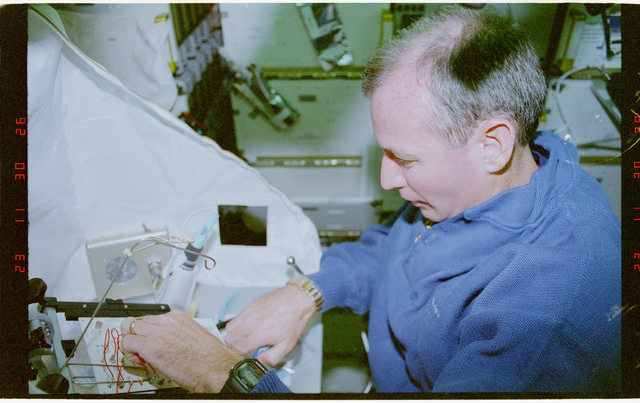STS057-30-037 - STS-057 - Crewmember in the SPACEHAB at work on physical stability and dexterity exp.