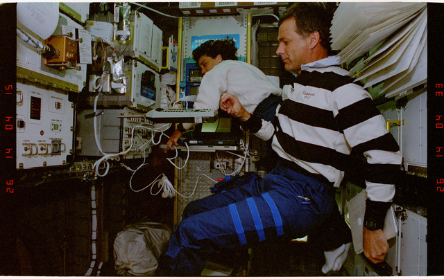STS057-40-021 - STS-057 - Crewmember in the SPACEHAB conducting Human Factors Assessment sound testing.