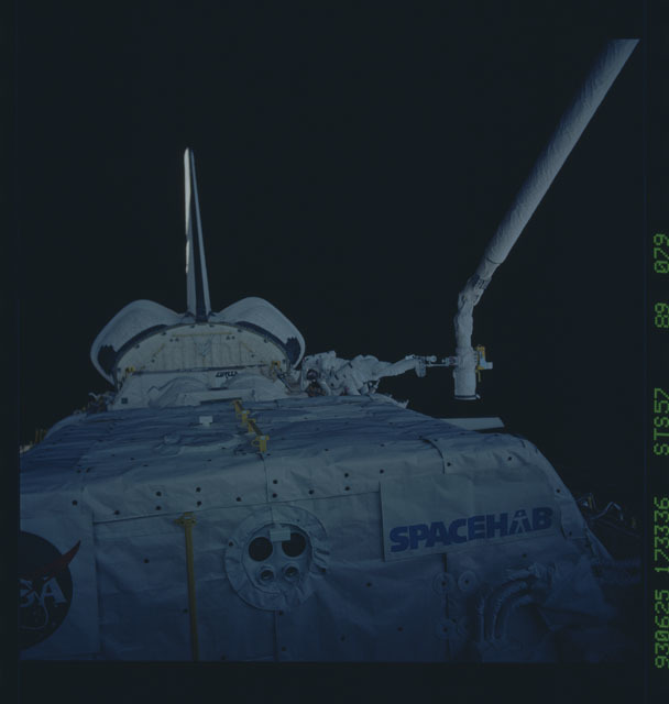 STS057-89-079 - STS-057 - DSO 1210 - Low and Wisoff perform an EVA during STS-57