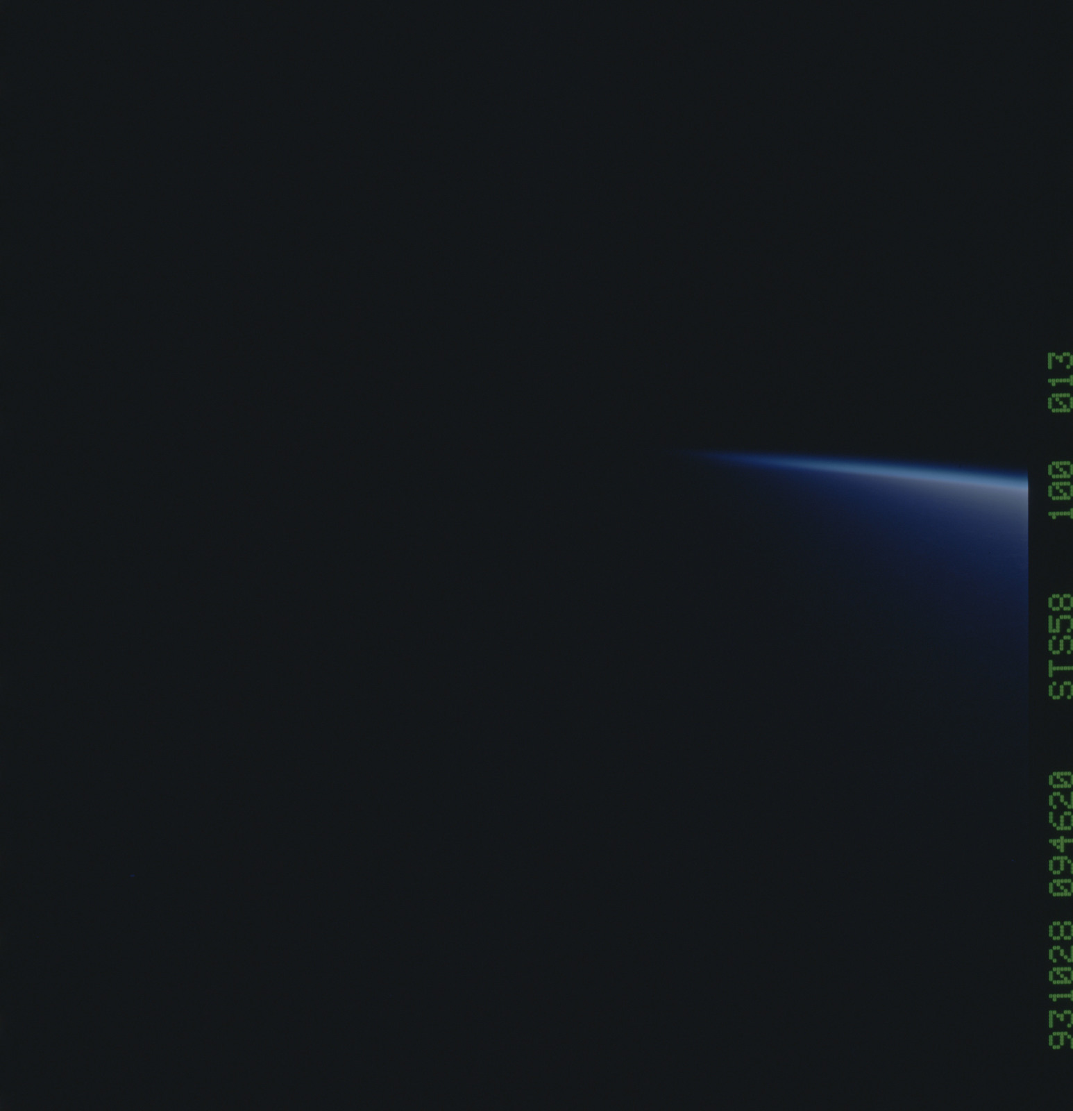 STS058-100-013 - STS-058 - Terminator barely visible over the Earth limb