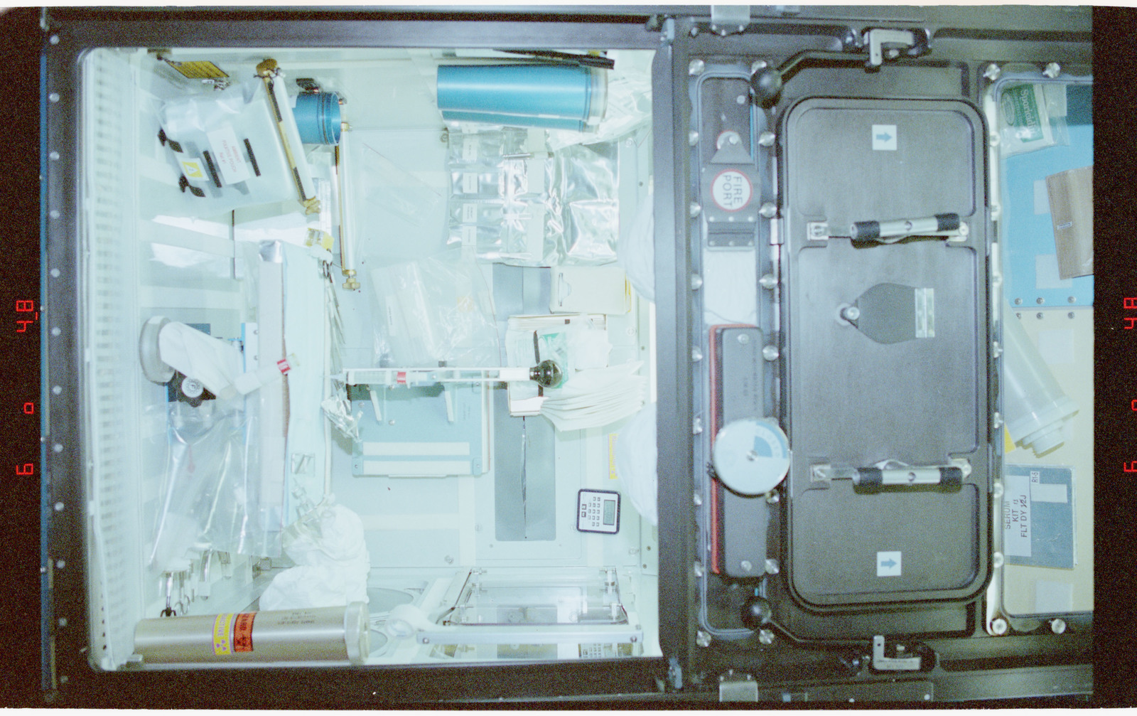 STS058-210-031 - STS-058 - Overhead views of the SPACELAB glovebox showing the animal dispatcher.