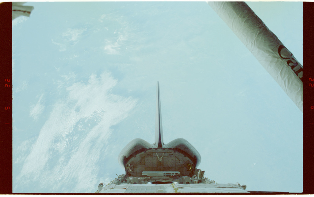 STS060-218-011 - STS-060 - View of the STS-60 Discovery's payload bay and RMS arm
