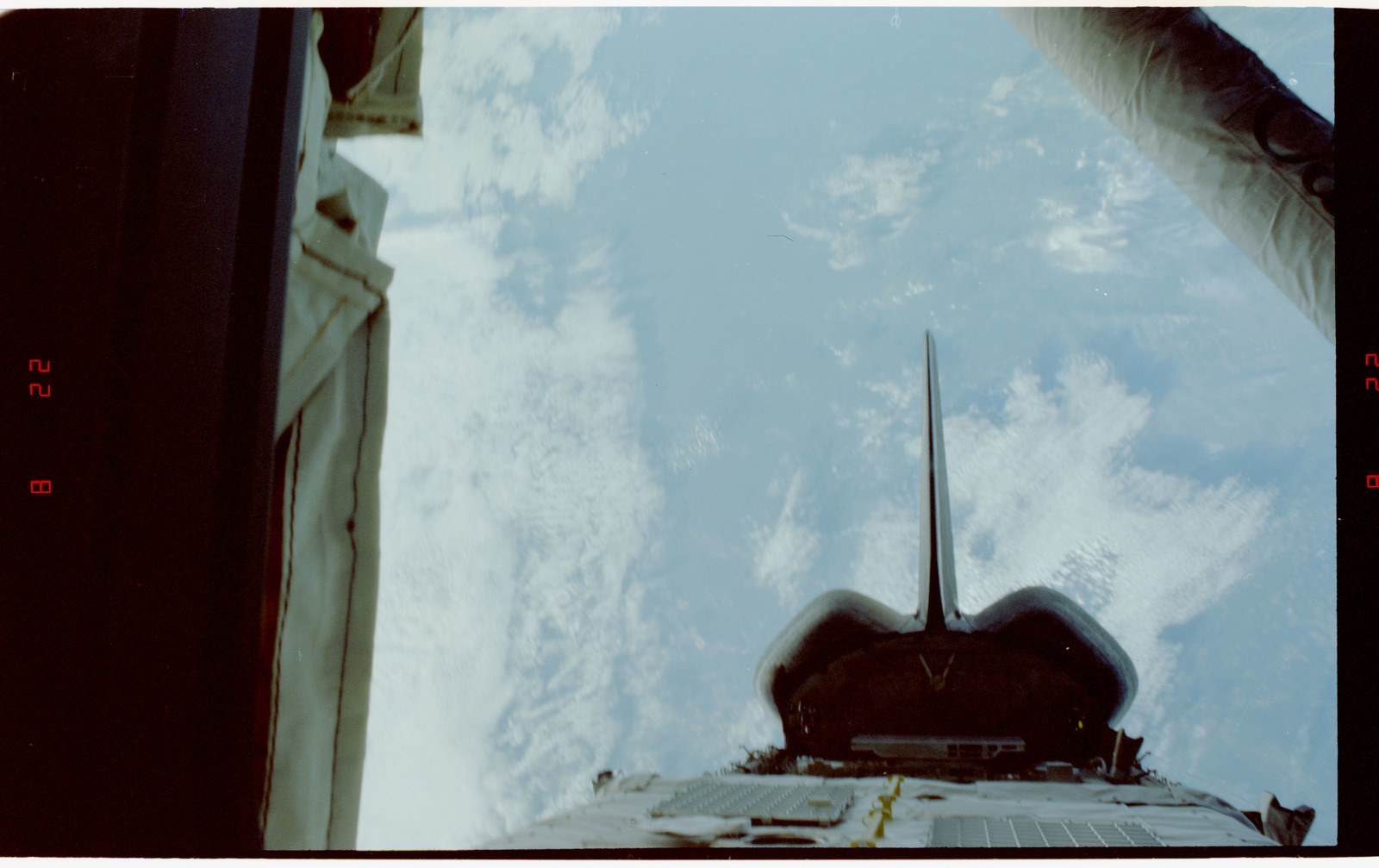 STS060-226-002 - STS-060 - View of the STS-60 Discovery's payload bay and RMS arm