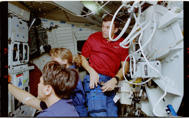 STS060-27-004 - STS-060 - Various views of STS-60 crewmembers on the middeck