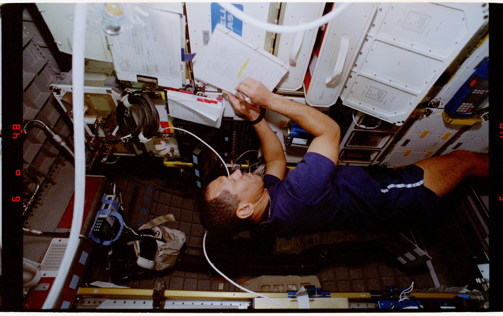STS060-29-019 - STS-060 - Bolden and Sega making notes while in Spacehab module