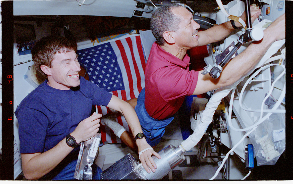 STS060-308-003 - STS-060 - Bolden uses shuttle vacuum cleaner on middeck