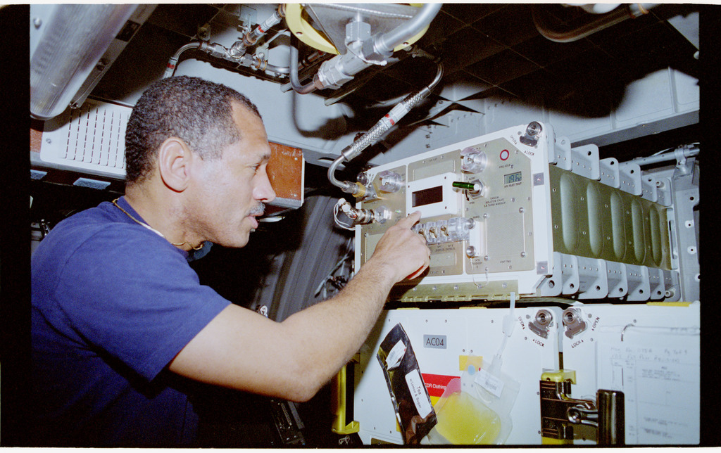 STS060-40-017 - STS-060 - ORSEP - Bolden works with experiment