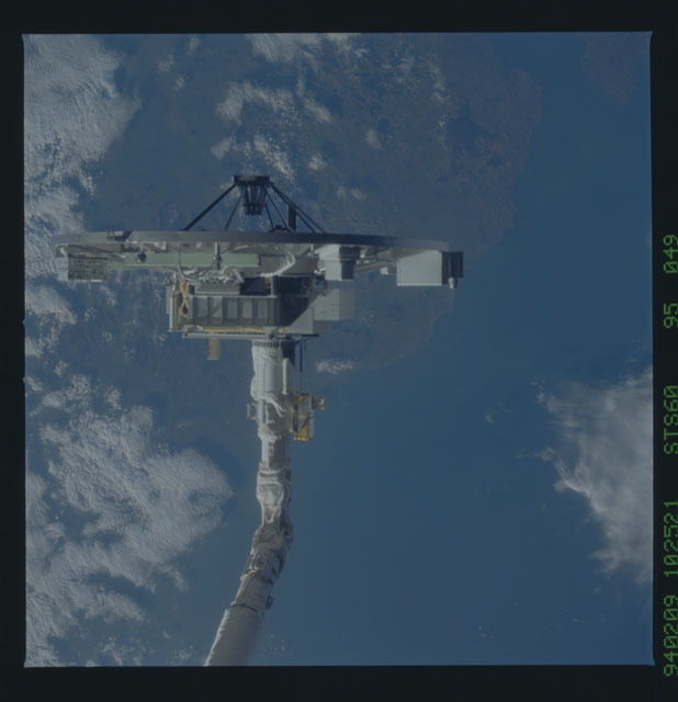 STS060-95-049 - STS-060 - APE B - Spectrograph Assembly attached to Discovery's RMS arm
