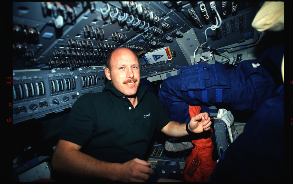 STS061-01-006 - STS-061 - Various views of STS-61 crew on aft flight deck with cameras