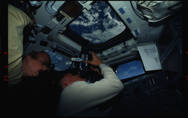 STS061-01-007 - STS-061 - Various views of STS-61 crew on aft flight deck with cameras
