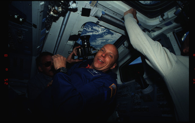 STS061-01-008 - STS-061 - Various views of STS-61 crew on aft flight deck with cameras