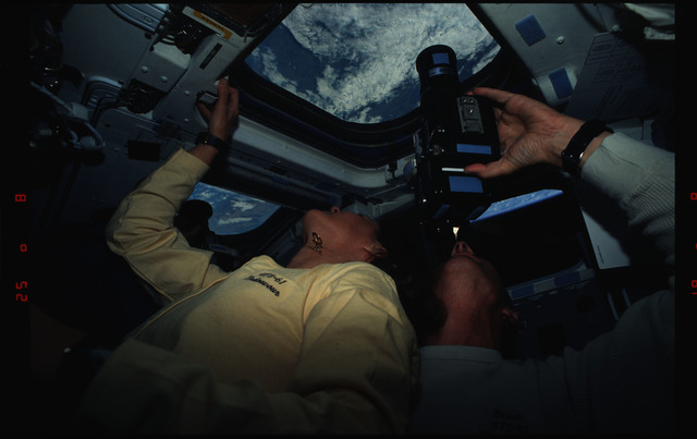 STS061-01-009 - STS-061 - Various views of STS-61 crew on aft flight deck with cameras