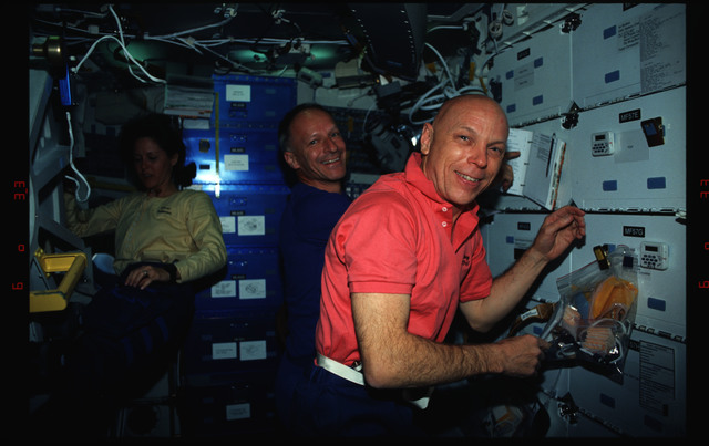 STS061-02-019 - STS-061 - Various views of the STS-61 crew on the Endeavour's middeck