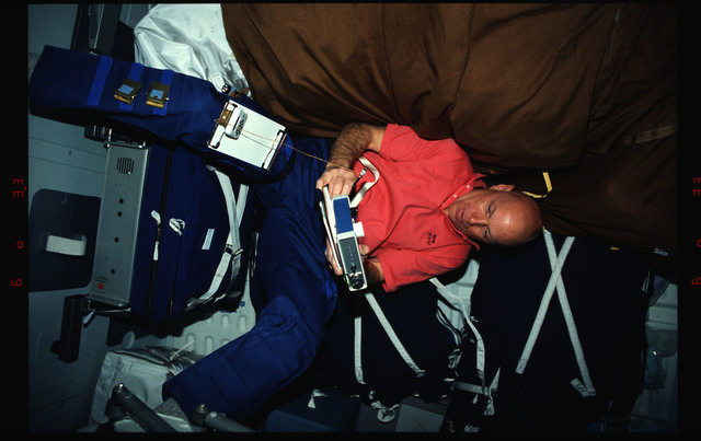 STS061-02-020 - STS-061 - Various views of the STS-61 crew on the Endeavour's middeck