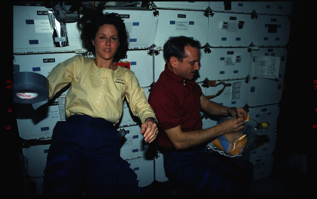 STS061-02-022 - STS-061 - Various views of the STS-61 crew on the Endeavour's middeck