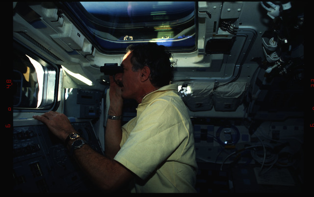 STS061-02-026 - STS-061 - Various views of the STS-61 crew on the orbiters flight deck