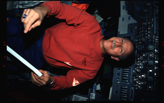 STS061-02-030 - STS-061 - Various views of the STS-61 crew on the orbiters flight deck
