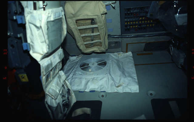 STS061-02-031 - STS-061 - Ventilation fan behind pilot's station on flight deck