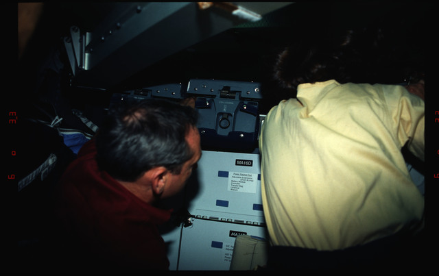 STS061-02-032 - STS-061 - Various views of the STS-61 crew on the Endeavour's middeck