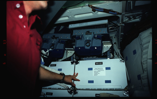 STS061-02-033 - STS-061 - Various views of the STS-61 crew on the Endeavour's middeck